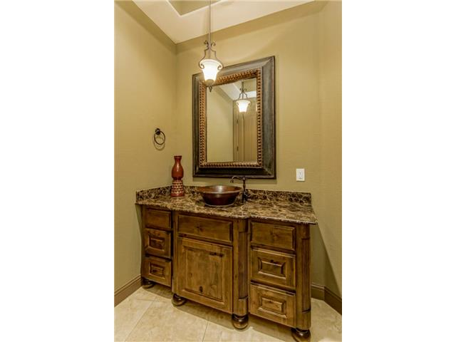 Powder bath with custom style furniture cabinet, marble counters