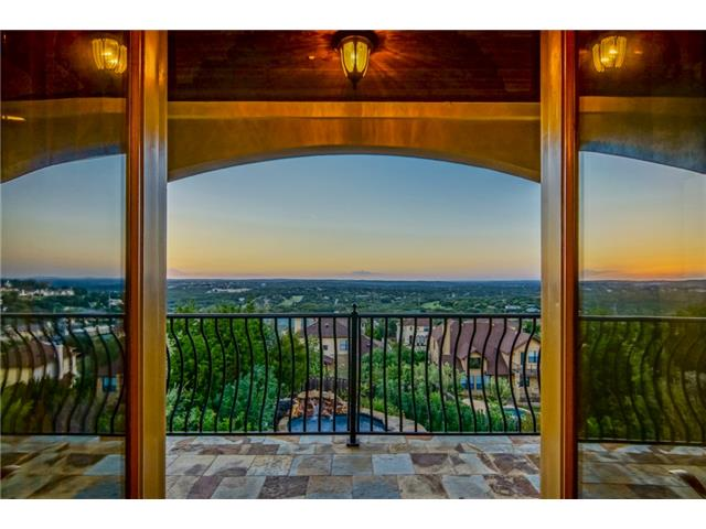 Double doors off the master lead to a balcony with a VIEW of the