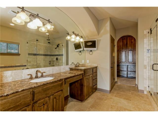 Master bath- Imperador marble counters, decorative light fixture