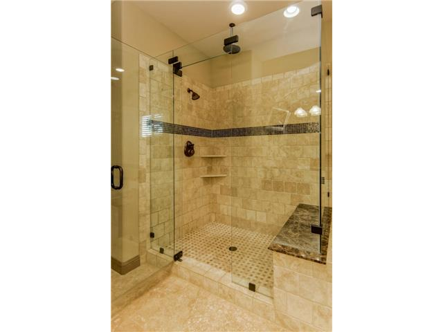 Large shower with seat and dual heads - check out the rain head