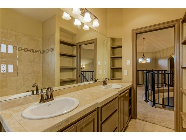 Bath 2 with dual vanities, travertine counters, cabinets with ad