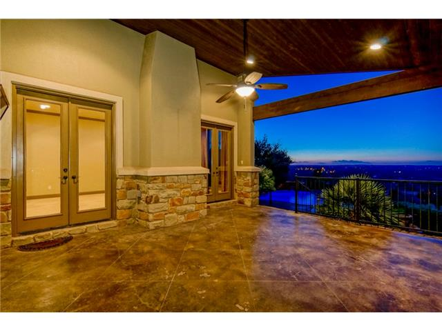 Entry to the covered patio overlooking the pool and waterfall.