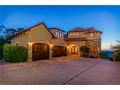 The front exterior elevation has Tuscan elegance with a twist of