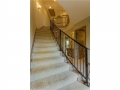 Entry Foyer has a sweeping staircase that leads to the bedrooms.