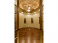 Right side of the foyer is anchored by a rotunda study with hand
